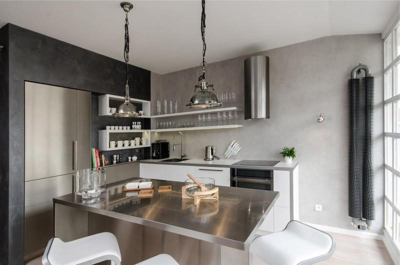 Murs de béton à l'intérieur d'une cuisine high-tech