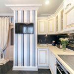 L-formet layout i køkkenområdet på 10 kvadratmeter. m