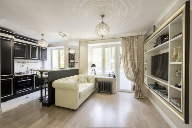 Egy egyszobás apartman kialakítása kis konyhával és nappalival