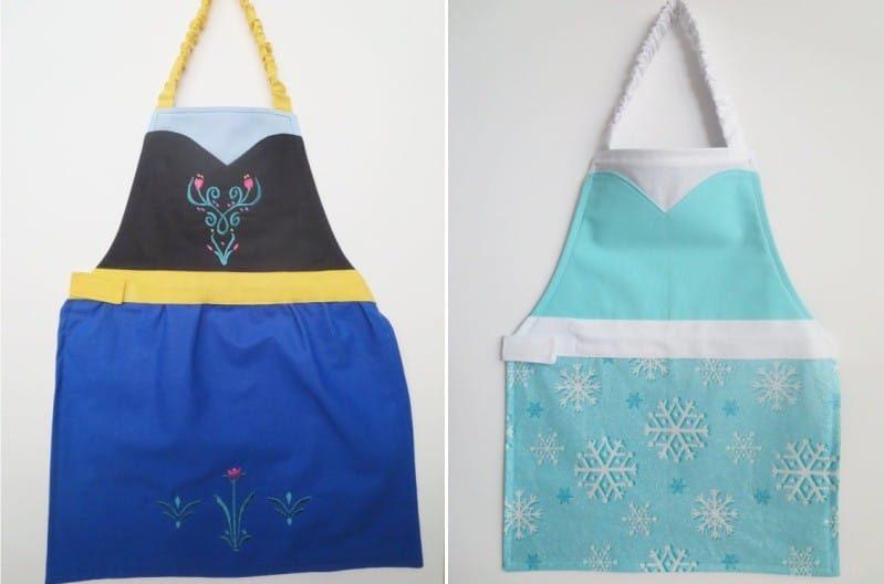 סינרי ילדים מעוצבים כמו שמלות של אלזה ושל אן מתוך הקריקטורה הלב הקרה