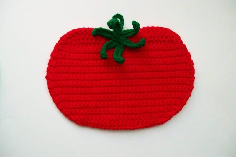 בעל סיר עגבניות בצורת הסרוגה