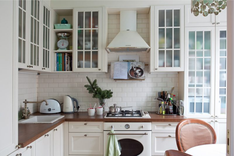 White kitchen with wooden countertop