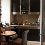 Beige tiles hog in the kitchen with a wooden countertop