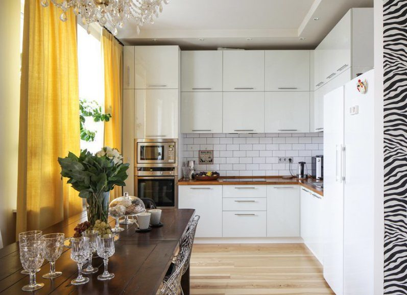 Interior of modern kitchen with wooden countertop