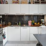 Mosaic apron in modern kitchen with wooden countertop