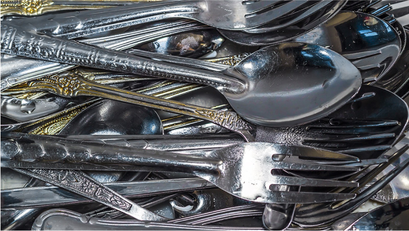 Dirty stainless steel cutlery